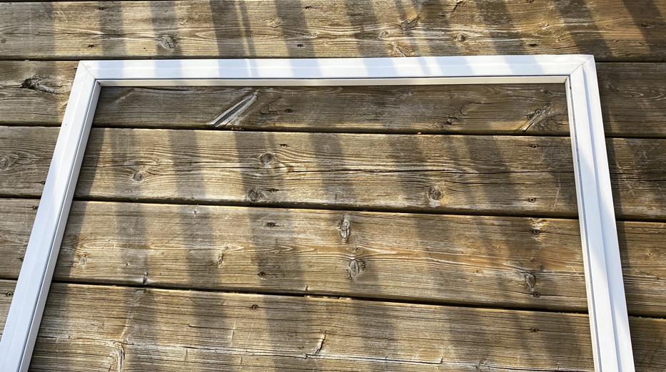 image of an empty patio door screen frame.