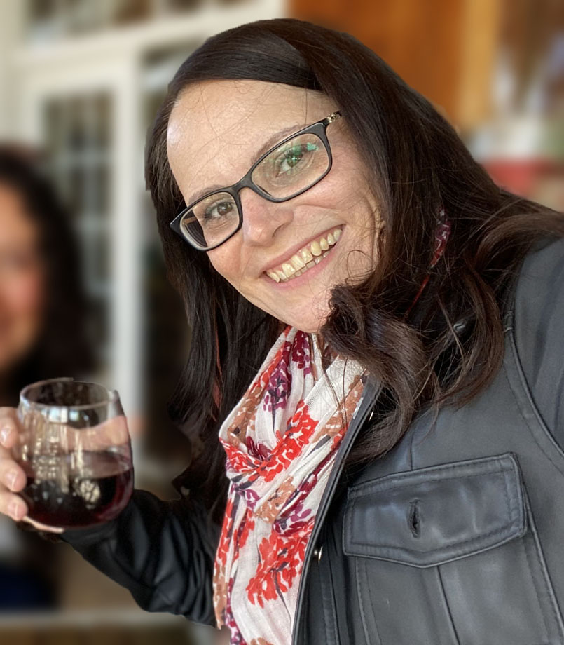 Image of woman at Good Earth Food and Wine tasting the Big Fork Red wine.