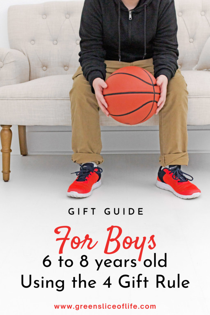 Image of boy with basket ball for gift guide for boys