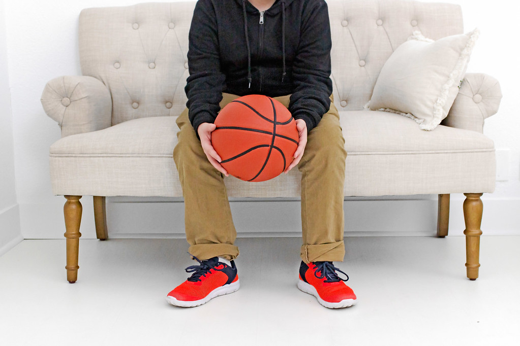 Image of boy with basket ball or gift guide for boys